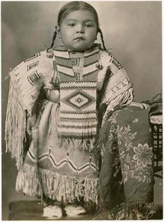 Cheyenne girl wearing an elaborate beaded dress and breastplate, 1915. Oklahoma | Photographer unknown