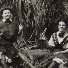Ladies (smoking and drinking!) with studio props of alligators