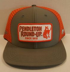 Orange and grey snapback Hooey hat with patch on front embroidered with  Pendleton Round-Up d54f86728890