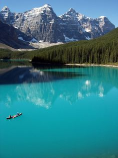 Moraine Lake, Banff National Park,  Alberta, Canada  I have been there and the water really is this color, it's beautiful! :)
