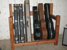guitar case rack - Woodworking Talk - Woodworkers Forum - I'd like to make something like this, but with an added shelf on top for books.