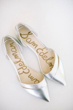 Photo: Caroline Frost Photography; Glorious metallic silver flat wedding shoes by Sam Edelman;