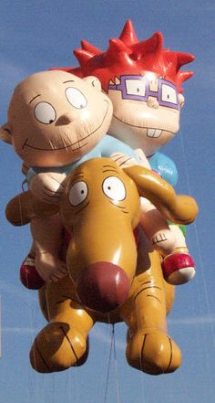 "Rugrats balloon on the ""Macy's Thanksgiving Day Parade"" on tv"