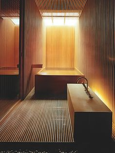 Japanese wood bath with great light. concrete tub and slab sink.... wood slat floor and walls... arkpad