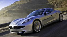 This is the Fisker Karma, a $100,000 electric sedan with a backup gasoline engine and the claim on a $529 million government loan meant to build the future of eco-friendly transportation.    Despite early defects that forced Fisker to issue a recall, along with a personal apology, Fisker still boasts that no other company that took the federal loans — Ford, Nissan and Tesla — has produced an all-new model as Fisker has.