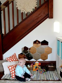 Use the wasted space under your stairs to make a baby play space - great idea!