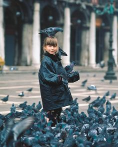 Photo by @michaelclarkphoto // Piazza San Marco in Venice, Italy. I have only spent one day in Venice but it left a lasting impression--as I am sure it did for this young girl. The pigeons are part of the fun in Piazza San Marco. This moment happened in a blink of an eye, she glanced over at me for a brief second and I snapped the shutter. #venice #italy #piazzasanmarco