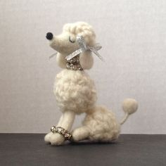 One fuzzy, needle felted snooty poodle in white with wire armature in legs. Only 3.5 inches tall! This is a special request for a customer. If