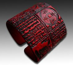 Items similar to Bold red and black Asian polymer clay cuff bracelet on Etsy