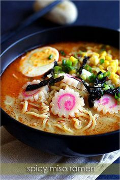 Ingredients:    Fresh ramen noodles (for two people)  4 cups water  4 tablespoons white miso paste  3-4 teaspoons S La Yu or chili oil   1/2 teaspoon hondashi   2 hard-boiled eggs  1/2 can corn kernels (15 oz can)  1 narutomaki (Japanese fish cake with a pink swirl)  1 stalk scallion (finely c