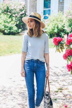 Casual lazy outfit. Straw hat, grey top and jeans