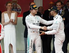 Lewis Hamilton sportingly offers race winner Nico Rosberg his hand as he makes his way on to the Monaco Grand Prix Podium. what was his team thinking ! Petronas, Nico Rosberg, Monaco Grand Prix, Lewis Hamilton, Ubs, Monte Carlo, Fast Cars, Victorious, Racing