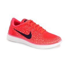 Nike 'Free RN Distance' Running Shoe (450 SAR) ❤ liked on Polyvore featuring shoes, athletic shoes, red, red running shoes, red flat shoes, running shoes, lace up flats and flat shoes