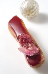 Raspberry éclair with rose perfume. The eclairs are filled with raspberry cream (raspberry puree, eggs, sugar, butter and gelatin) and have a raspberry glaze (sugar, milk, cream, gelatin, glucose, white choc.)
