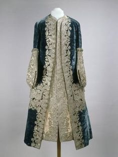 """1727-1730 French Coat and waistcoat worn by Tsar Peter II at the Moscow Kremlin Museums - """"In this ensemble the silk of the waistcoat and coat cuffs has faded considerably. It was once a vibrant pink, an elegant contrast to the deep blue velvet of the coat. Both garments are decorated in silver embroidery, worked separately then applied to the velvet and taffeta, rather than embroidered directly onto the coat and waistcoat."""" by caitlin"""