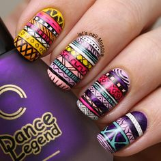 Some solid tribal patterns. Check this girl out if you want some awesome ideas. Magazine.nailpolis.com