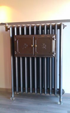 Original historical cast iron radiators dated with year around 1900 with warm up rack. Fully renovated by Laurens in Belgium.