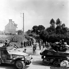 July 31st, 1944: troops belonging to the 6th Armored Division American crossing a column of German prisoners at La Rochelle-Normande.