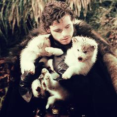 """""""Robb Stark holding direwolf puppies. You're welcome."""" yet all I can think of is """"the red wedding"""" :'( there is something wrong with me..."""