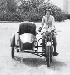 Easter Walters, an early actress and motorcycle enthusiast. Here Easter rides an early 1920s Harley-Davidson with a sidecar.
