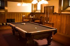 Billiard room- I like the table in the corner and the low bench for seating