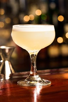 """5 Speakeasy Cocktails...And Their Shady Pasts #refinery29 http://www.refinery29.com/46674#slide5 White Lady Introduced in the late '20s, The White Lady was born from the drink the """"Delilah,"""" which included crème de menthe. The Savoy's Harry Craddock replaced it with orange liqueur, and it became an instant classic. 1.5 oz Tanqueray London Dry Gin .75 oz orange liqueur .75 oz lemon juice Pour all of the ingredients into a shaker, fill with ice, shake and strain into a chilled coupe glass."""