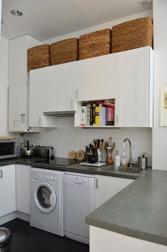 Use baskets to store items in the space above the cabinets to gain extra storage in a small kitchen
