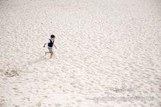 Wedding guest on Sandbanks Beach. Photography by one thousand words wedding photographers