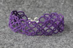 Upside down purple tatted bracelet.