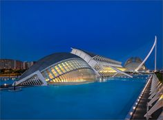 Calatrava and the blue hour - L'Hemisfèric and Museo de las Ciencias Príncipe Felipe in the Ciudad de las Artes y de las Ciencias, in Valencia.  L'Hemisfèric (in the foreground)  The IMAX 3D Cinema, Planetarium and Laserium Is as an opening and closing eye  To about 13,000sqm has been constructed.  Museo de las Ciencias Principe Felipe (back)  In this three-story, interactive science museum, a selection of natural laws is vividly illustrated.
