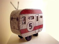 """CERAMIC TRAILERS can help ease the pain of waiting for your own. Corrien Vegter, an Oregon artist who owns and operates a studio with her fellow artist and husband, in Baker City. Her work and studio, 'Dusty Dog are a treat for the enthusiast.  She creates vintage inspired ceramic travel trailers that are lamps (think night light). She does custom orders and can do a ceramic version of a trailer you own.   This is a fun one. """"Number 5"""""""