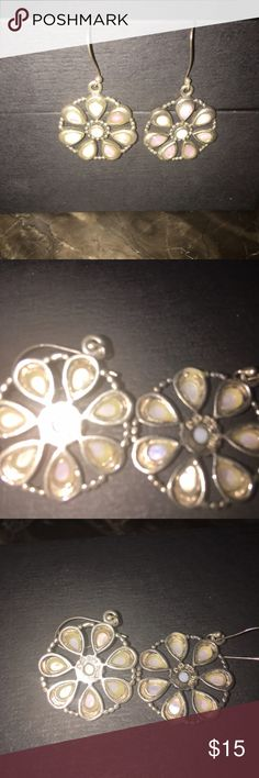 Earrings sterling silver 925 dangling Sterling silver earrings dangling about the size of a nickel. Pink stones Jewelry Earrings