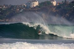 Surfer on large wave at Zicatela Beach, famous surfing beach also known as Mexican Pipeline. - Paul Kennedy / Getty Images