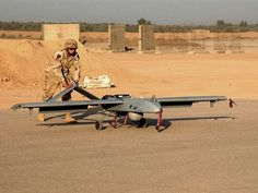 Spc. Jeremy Squirres of Company A, 101st Military Intelligence Battalion, 3rd Brigade Combat Team, 1st Infantry Division, prepares an AAI RQ-7 Shadow 200 UAV for launch at Forward Operating Base Warhorse, Iraq. Unit Cost Per Aircraft: US$750,000.00 (2011 dollars)