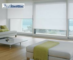 Modern Kitchen Blinds white silent gliss roller blinds in an ultra-modern living room