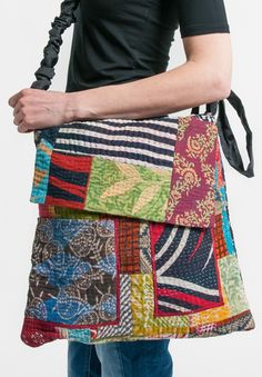 $285 | Mieko Mintz 5-Layer Vintage Kantha Cotton Messenger Bag in Multicolored Patchwork | Mieko Mintz creates clothing from vintage saris, which are upcycled into new fashion. The reversible clothing is an artful combination of by Mieko that is then made into kantha fabric. This handbag is made from vintage fabric into a patchwork pattern. Sold online and in-store at Santa Fe Dry Goods in Santa Fe, New Mexico.
