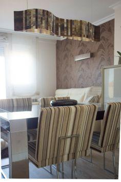 Viviendas diseñadas por el estudio ELA Interiorismo de Santiago de Compostela. Salón reformado consiguiendo calidez