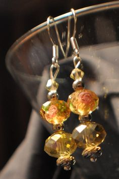 http://www.etsy.com/listing/90568406/yellow-rose-swarovski-earrings    $12