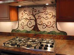 Colorful tree mosaic kitchen backsplash ideas