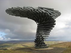 The Singing Ringing Tree sound sculpture in England. As wind moves through the different lengths of steel pipe, it plays different chords. Tonkin Liu Architects, 2006.