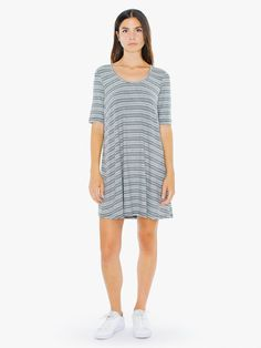 A casual, shift silhouette constructed from soft, 2x1 baby rib for a soft, comfortable wear. The 2x1 Rib Stripe T-Shirt Mini Dress features a 70's style stripe pattern, low scoop neckline, total neckband, elbow length sleeves, and mini length. This dress wears true to size in a relaxed fit with moderate stretch and is thicker than the 2x2 Rib T-Shirt Dress.
