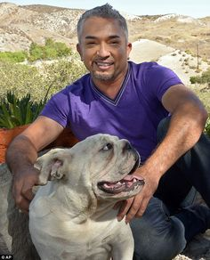 At home: Cesar Millan poses with his English Bull Dog George at his Dog Psychology Center in Santa Clarita, California on October 18