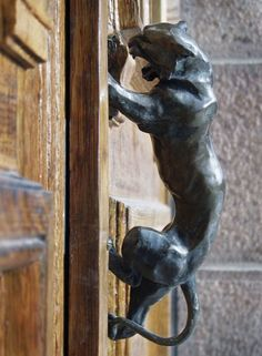 the door knocker/handle is sculpture too! exciting door handles make you happy everyday.
