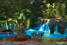 Pool with multiple rock waterfalls and a secret entry to the grotto
