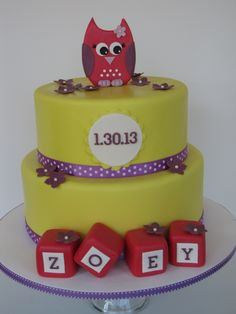 Owl Baby Shower Cake - This baby shower cake was for a little girl to be named Zoey. The owl is fondant and the blocks are rice krispies covered in fondant. The baby's due date is on the plaque on front. Inspired by a cake by The Designer Cake Company.