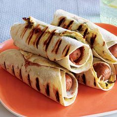 Pigs in Ponchos (Tortilla-Wrapped Franks and Beans) - Pigs in Ponchos--Rachael Ray recipe for hot dogs, tortillas, and refried beans Hot Dog Recipes, Bean Recipes, Kid Recipes, Tortilla Wraps, Comida Latina, Party Dips, Party Snacks, 30 Minute Meals, Bon Appetit
