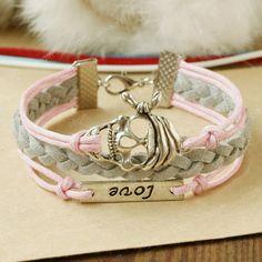 Skull Bracelet - the pure love bracelet -pink and grey combination bracelet gift for every princess. $7.99, via Etsy.