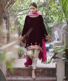 A vibrant magenta velvet kurti in our signature box cut inspired by a traditional phiran . Ideal for a cosy winter afternoon Velvet Pakistani Dress, Pakistani Party Wear Dresses, Shadi Dresses, Pakistani Wedding Outfits, Pakistani Dress Design, Indian Dresses, Indian Outfits, Pakistani Couture, Wedding Hijab