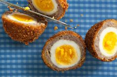 Breakfast Sausage and Cornflake Scotch Eggs by Chow. A recipe for Scotch eggs that uses breakfast sausage and crushed cornflakes to coat the boiled eggs, which are then topped with a maple syrup drizzle. Sausage Breakfast, Breakfast Recipes, Breakfast Ideas, Perfect Breakfast, Scotch Eggs Recipe, Think Food, Sausage And Egg, Sage Sausage, Egg Recipes