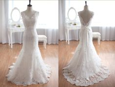 Vintage Inspired Tulle Lace Wedding Dress Taffeta Bridal Gown Deep V Open Back Mermaid Dress. $449.00, via Etsy.